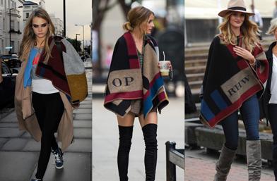 Коя го носи по-добре - Кара, Роузи или Оливия в бохо пончото на Burberry Prorsum