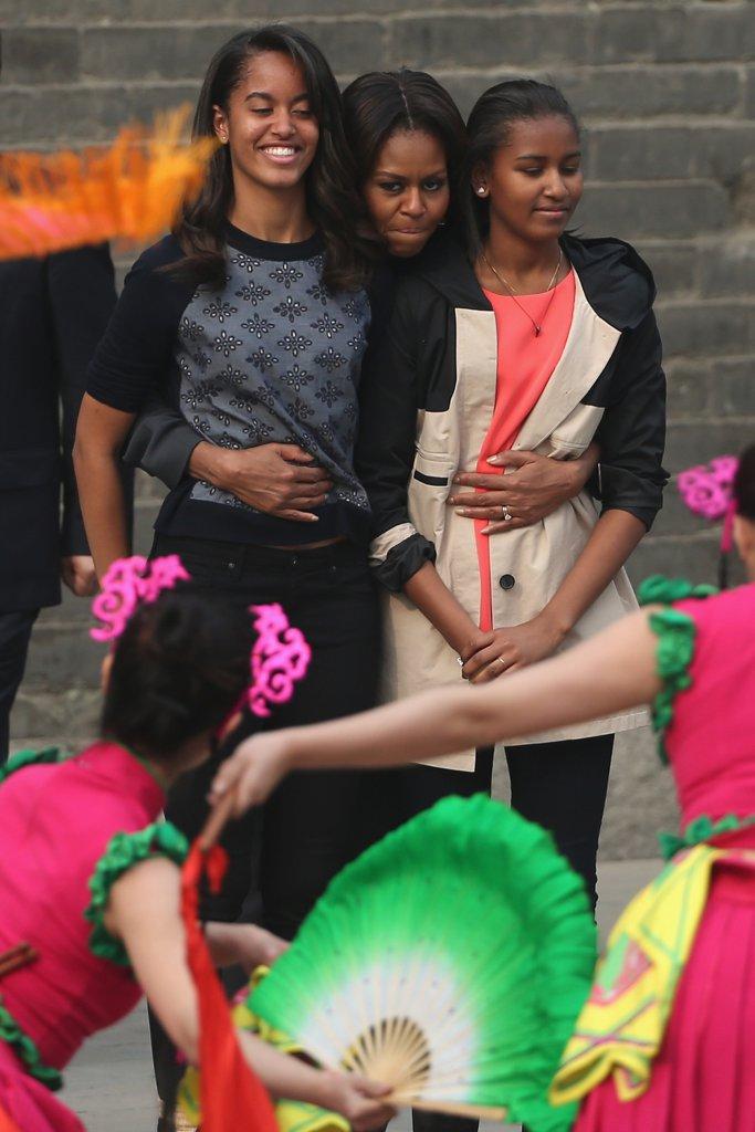 Триото Обама през 2014 по време на посещението си в Китай.