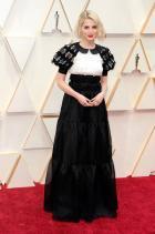 Луси Бойнтън Облечена в Chanel заНаградите на филмовата академия на САЩ.